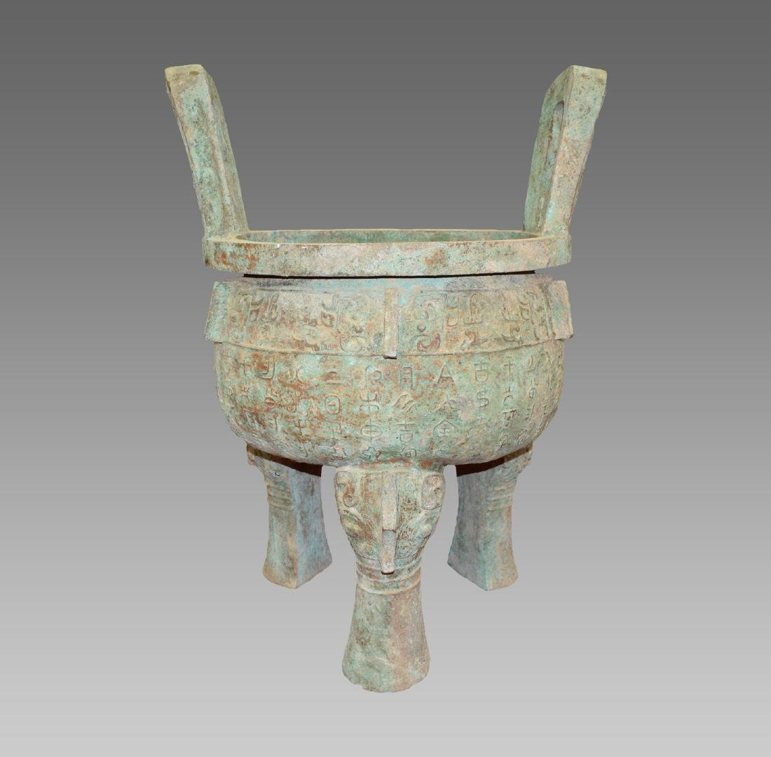 AN OLD CHINESE COPPER TRIPOD CENSER