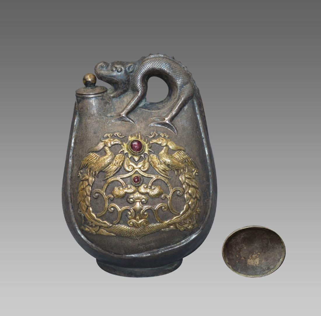 A CARVED SILVER GILT FLAT FLASK