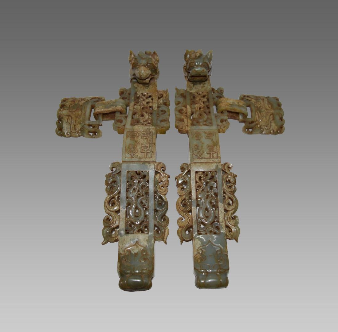 A PAIR OF BEAST DESIGN ANCIENT JADE WEAPON
