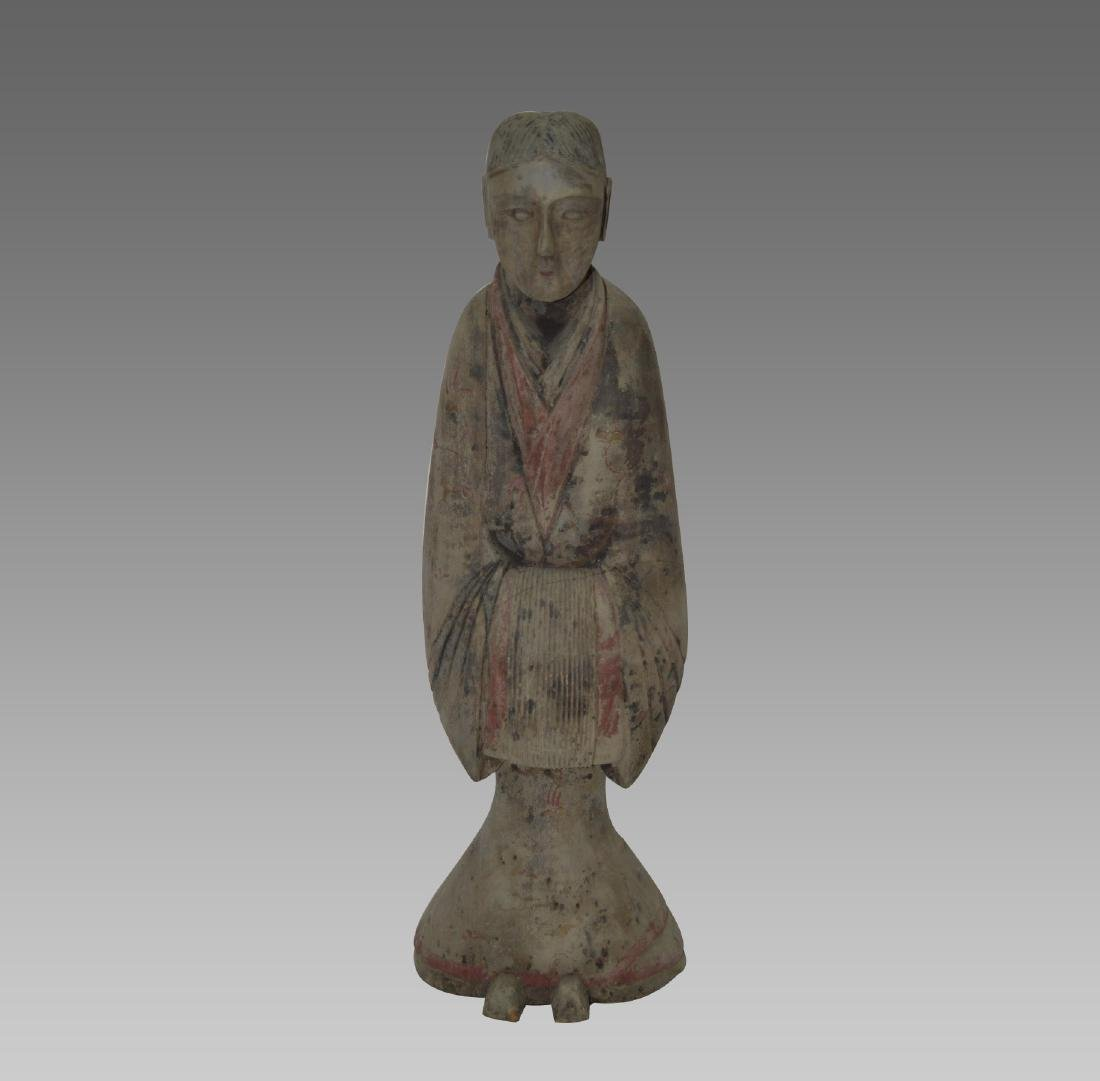 A PAINTED POTTERY FIGURE