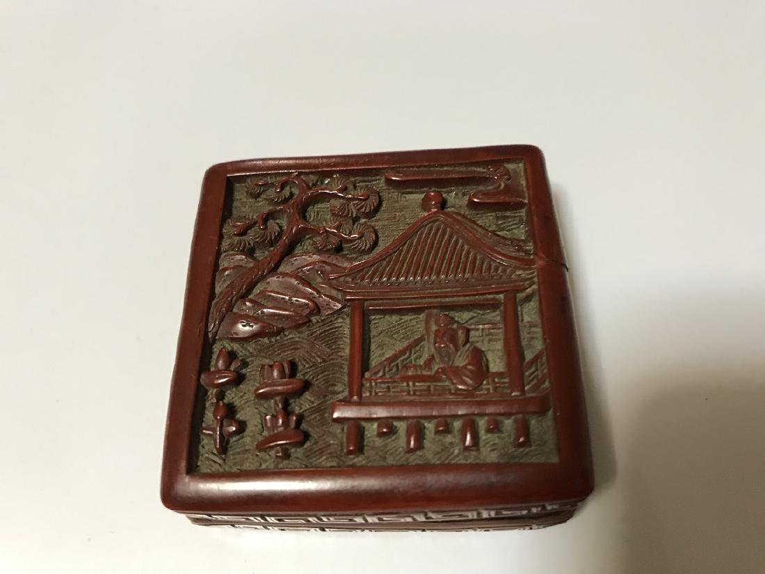 A SMALL OLD CHINESE CARVED CINNABAR SQUARE BOX AND