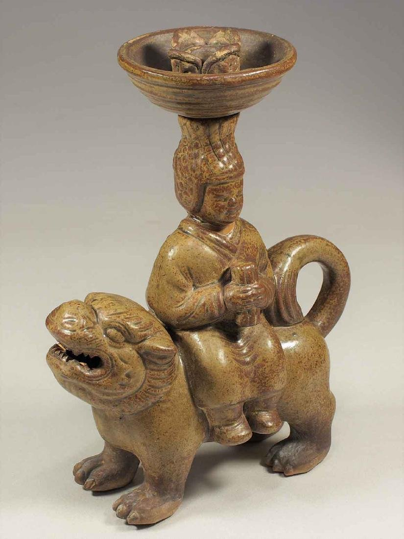 Celadon Lamp with Man Seating on Qilin Form, Eastern