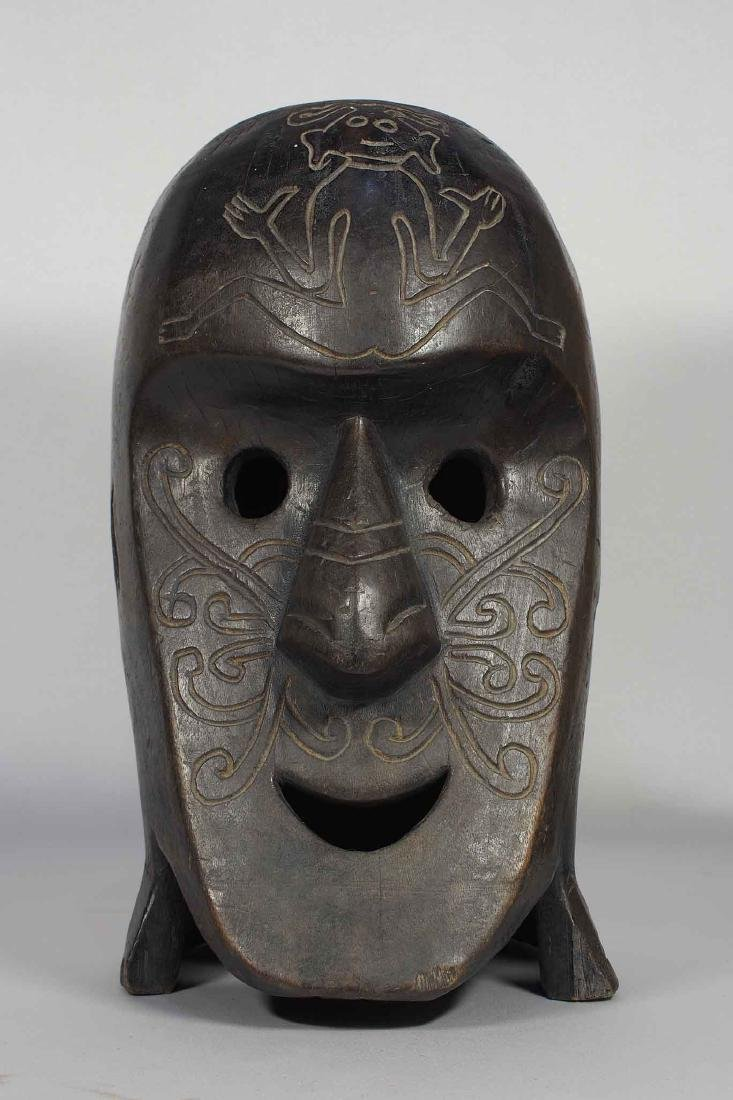Old Carved Wood Mask with Incised Design, Dayak Borneo