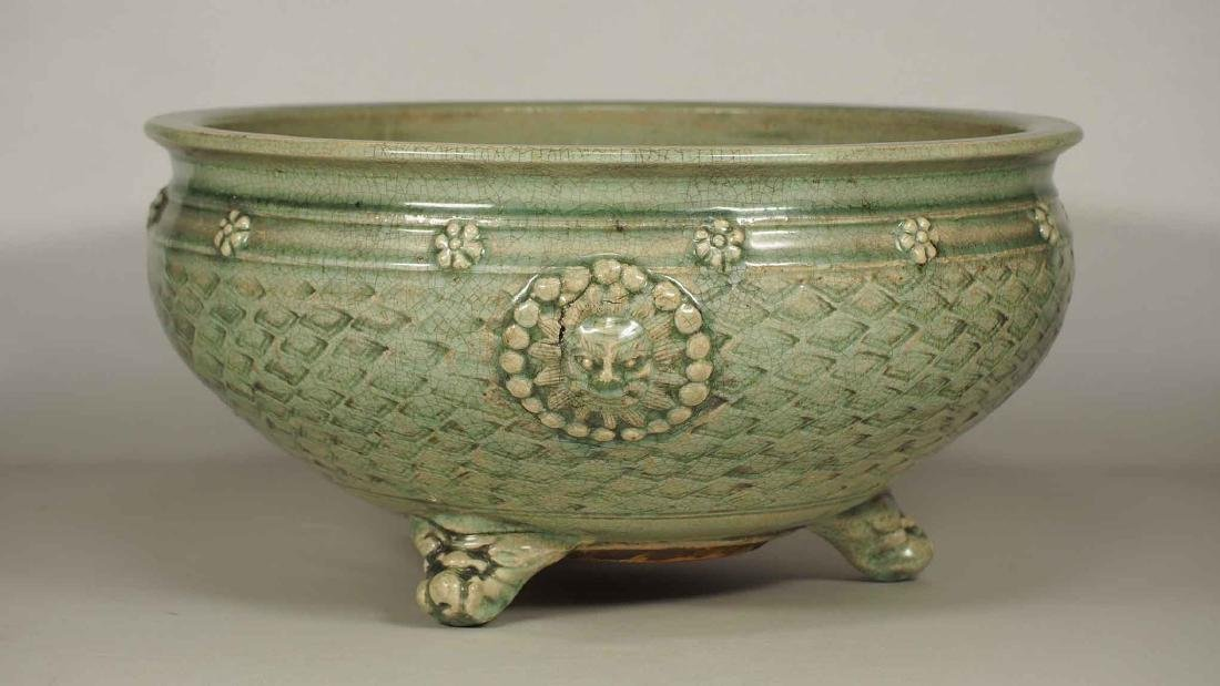 Longquan Large Tripod Censer with Moulded Qilin Face,