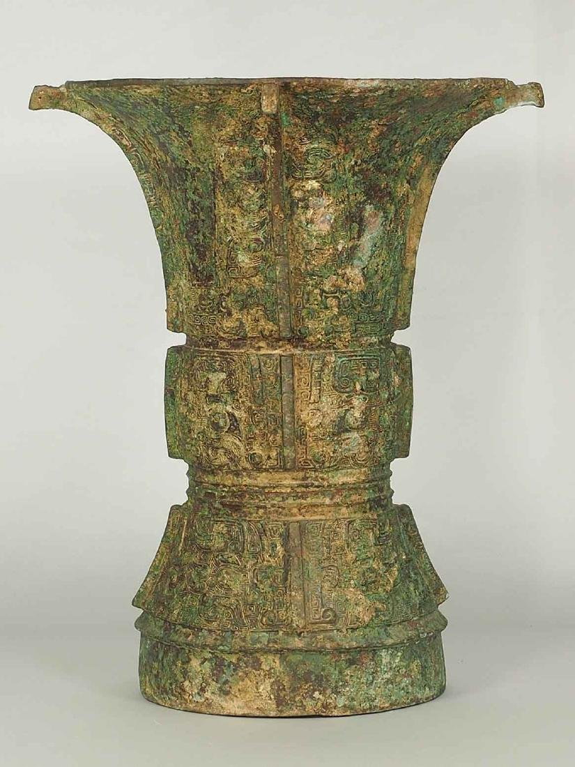 Gu' Bronze Wine Vessel with Double Taotie Masks, Shang