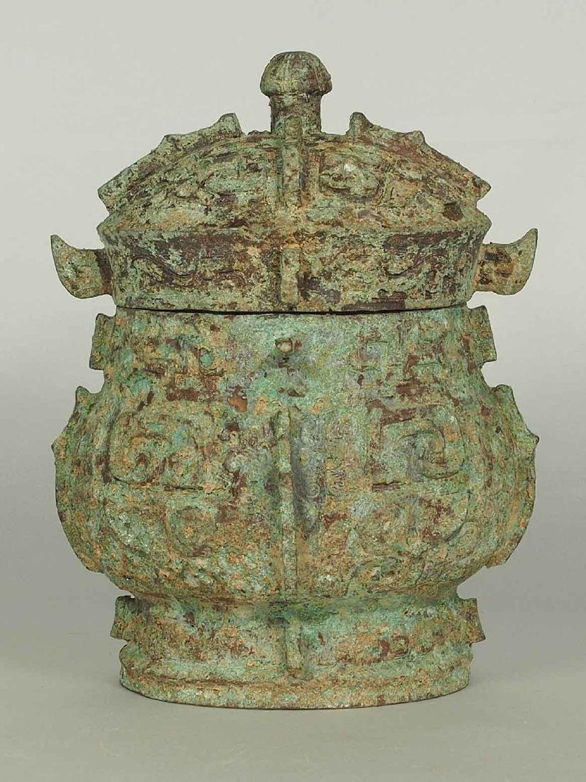 You' Bronze Wine Vessel with Taotie Mask, early Western