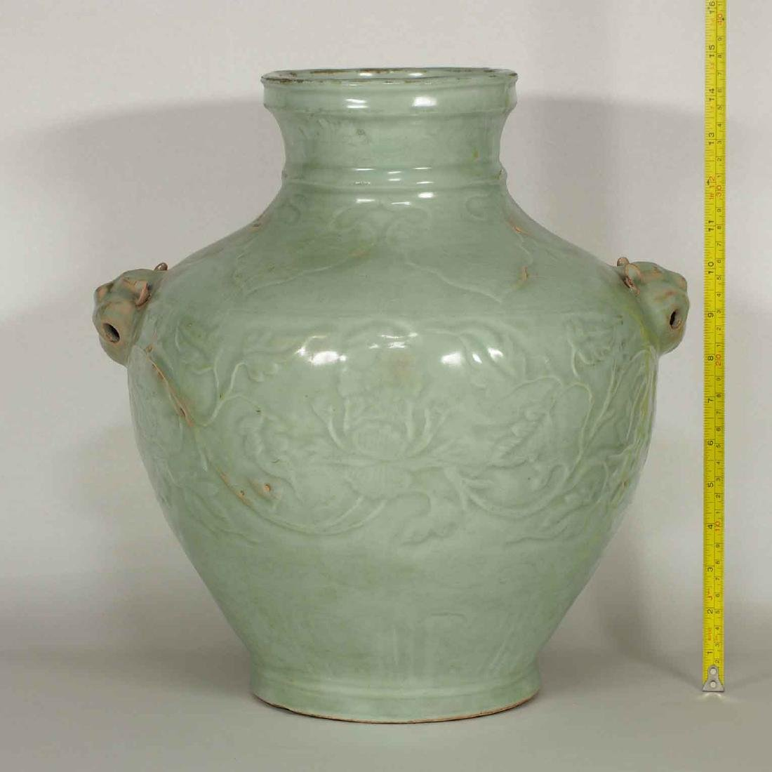 Longquan Hu-form Jar with Carved Peony Scroll, early - 11