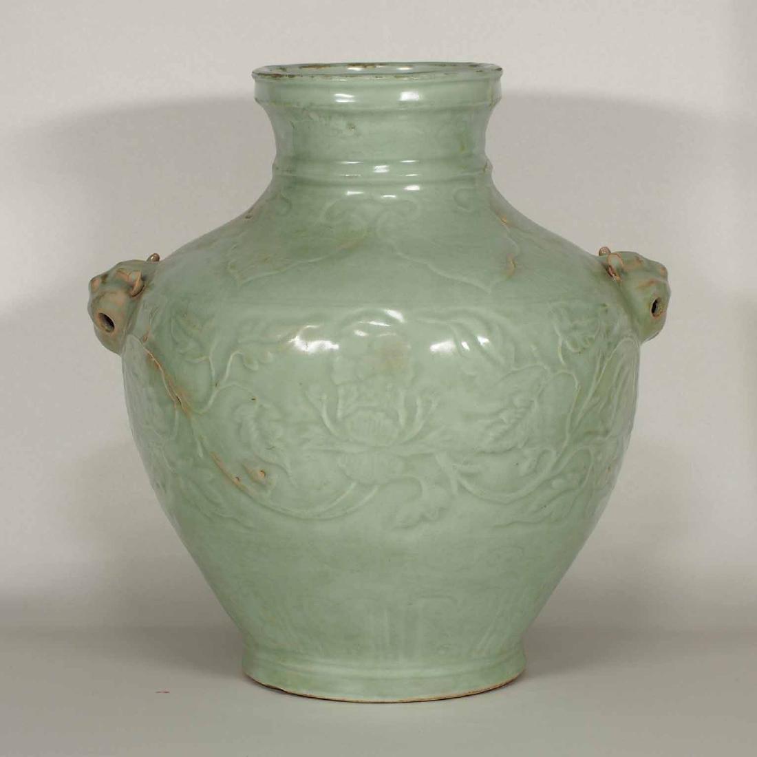 Longquan Hu-form Jar with Carved Peony Scroll, early
