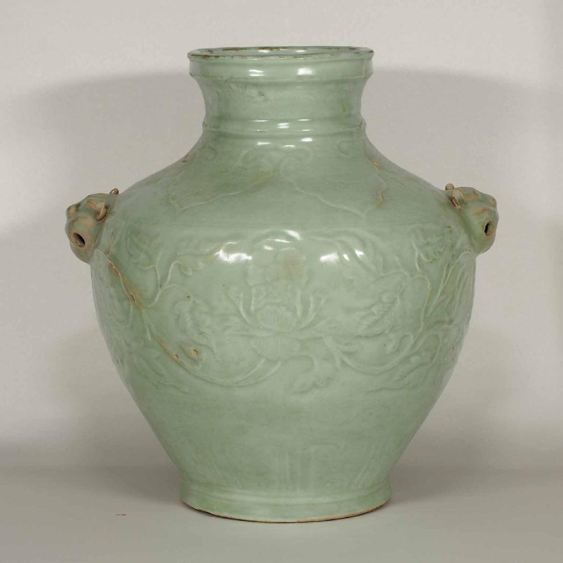 Longquan Hu-form Jar with Carved Peony Scroll, early
