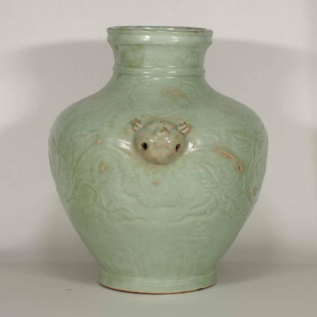 Longquan Hu-form Jar with Carved Peony Scroll, early - 2