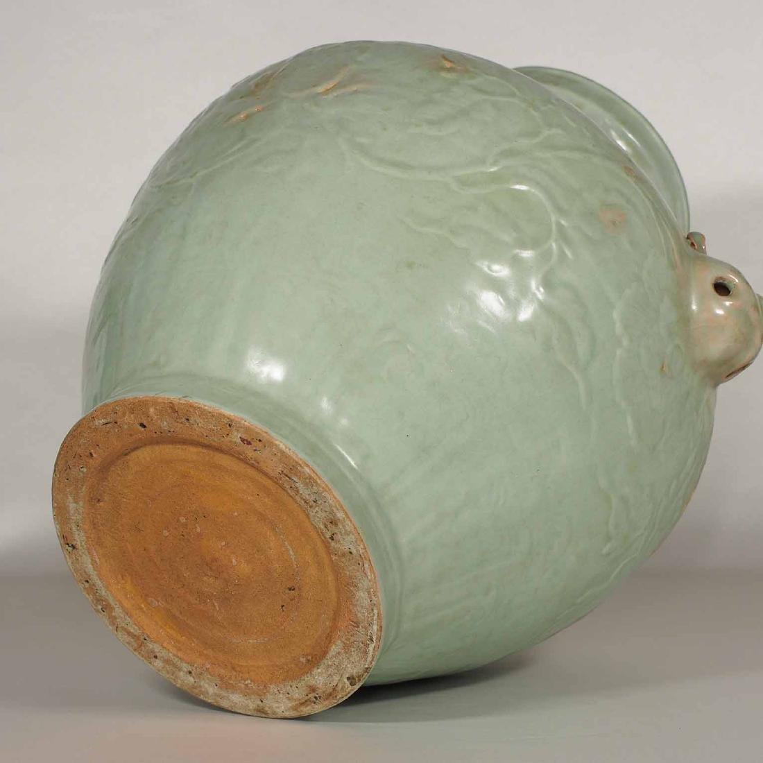Longquan Hu-form Jar with Carved Peony Scroll, early - 9