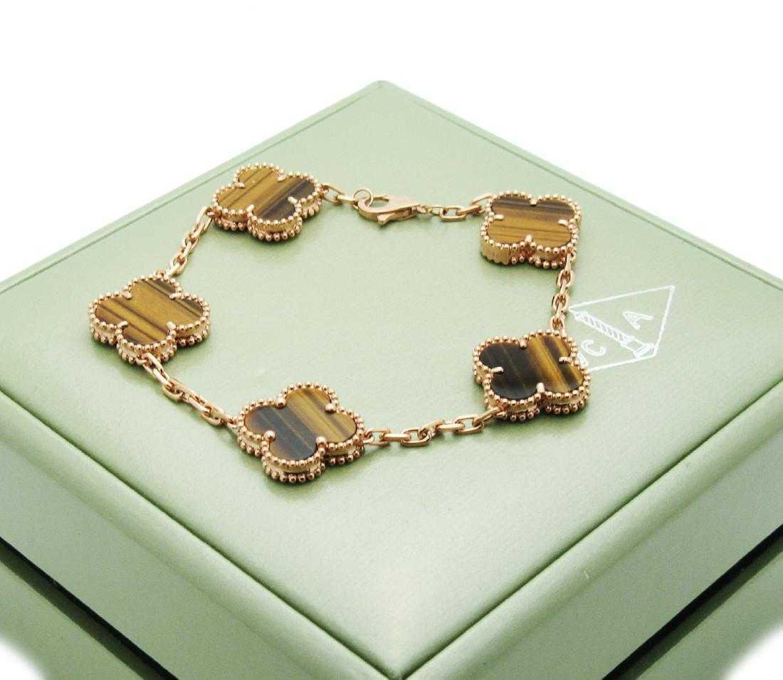 b74cfcde644a3 Van Cleef   Arpels 18k Rose Gold Tiger Eye Alhambra