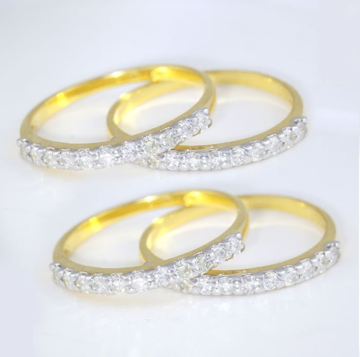 14 K / 585 Yellow Gold set of 4 Diamond Band Rings