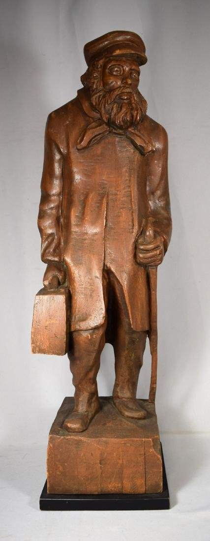 CARVED WOODEN FULL FIGURE of a IMMIGRANT MAN: