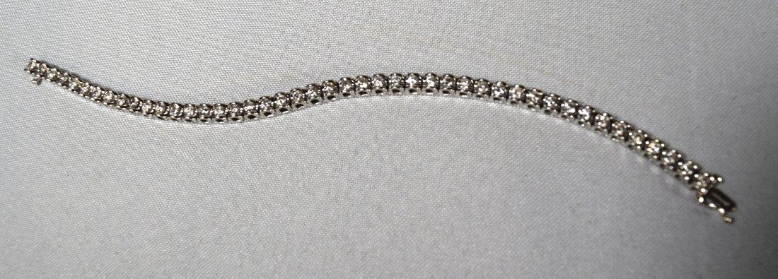 DIAMOND & 14KT WHITE GOLD TENNIS BRACELET: - 5