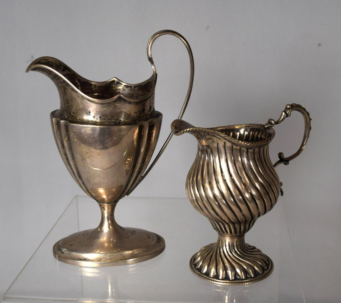 TWO CONTINENTAL SILVER CREAMERS: