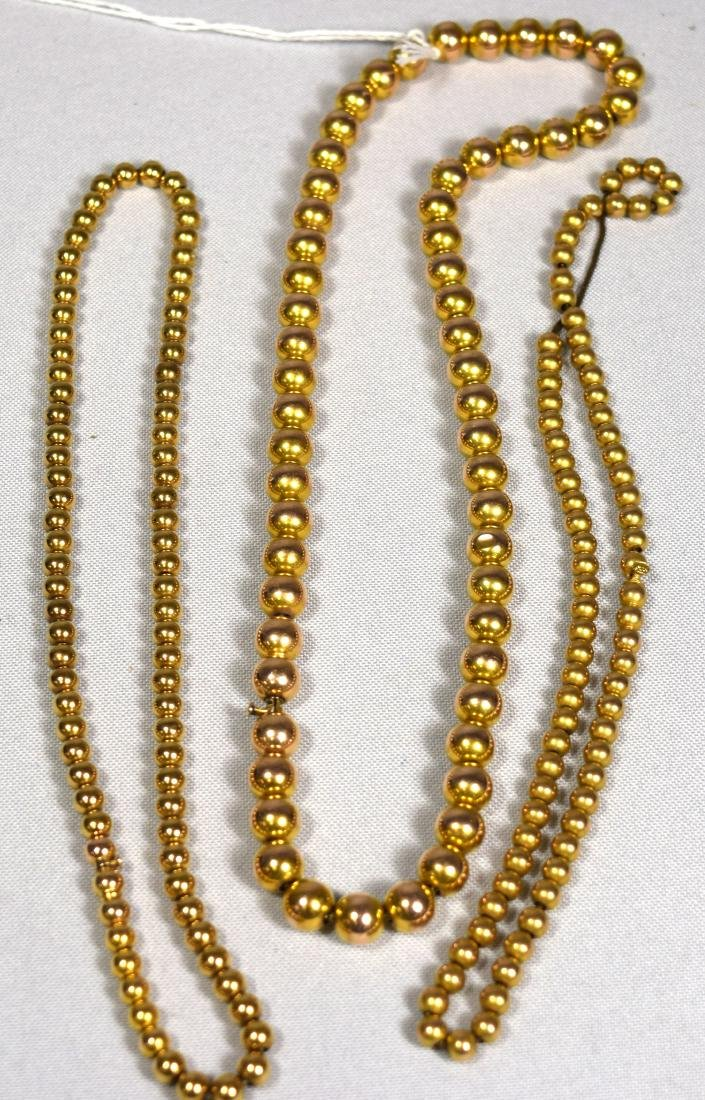 THREE 14KT YELLOW GOLD BEAD NECKLACES: - 2