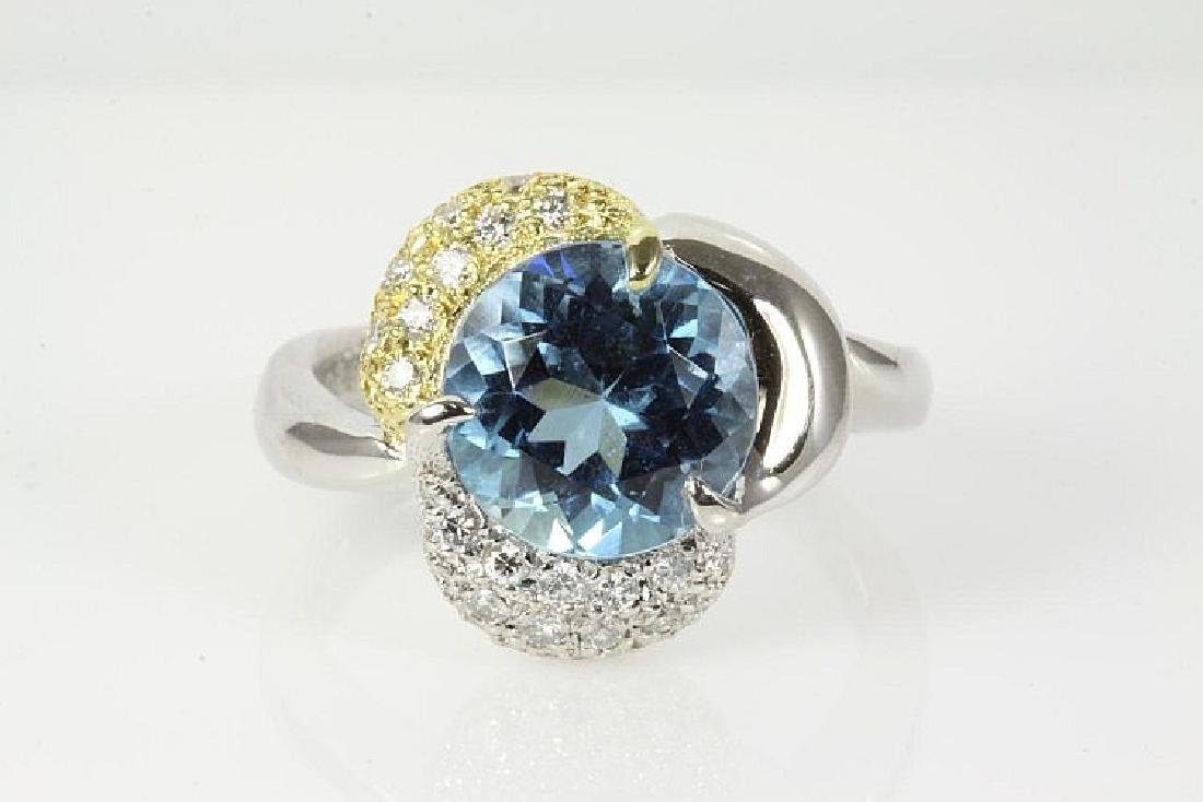 Round Aquamarine and Diamond Ring
