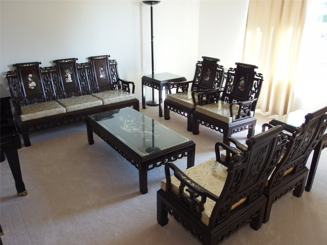 A set of Chinese old-style wood sofas. Includes a three