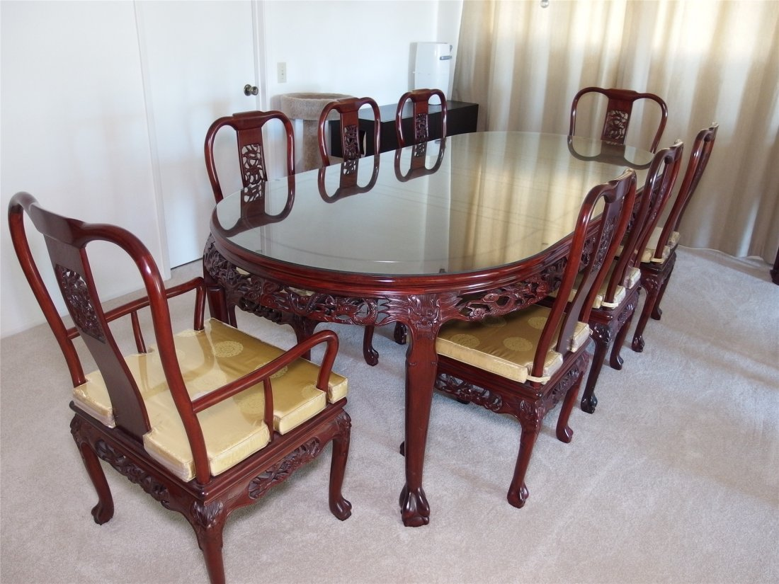 A set of Chinese vintage dining tables and chairs.