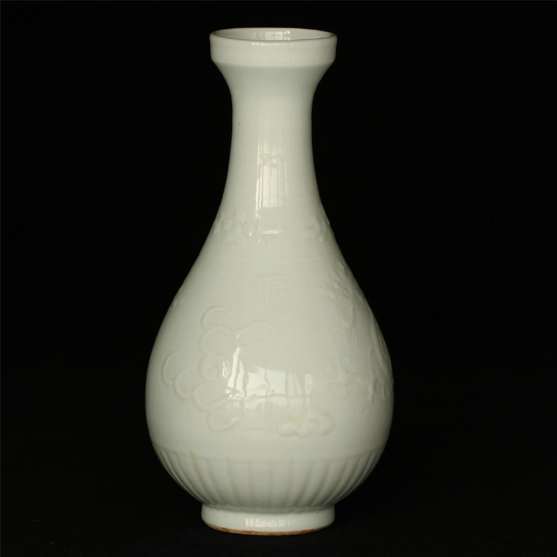 White porcelain carving vase of ShuFu mark.
