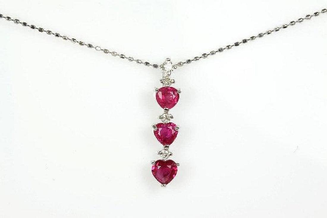 Ruby and Diamond pendant with heart shaped Rubies