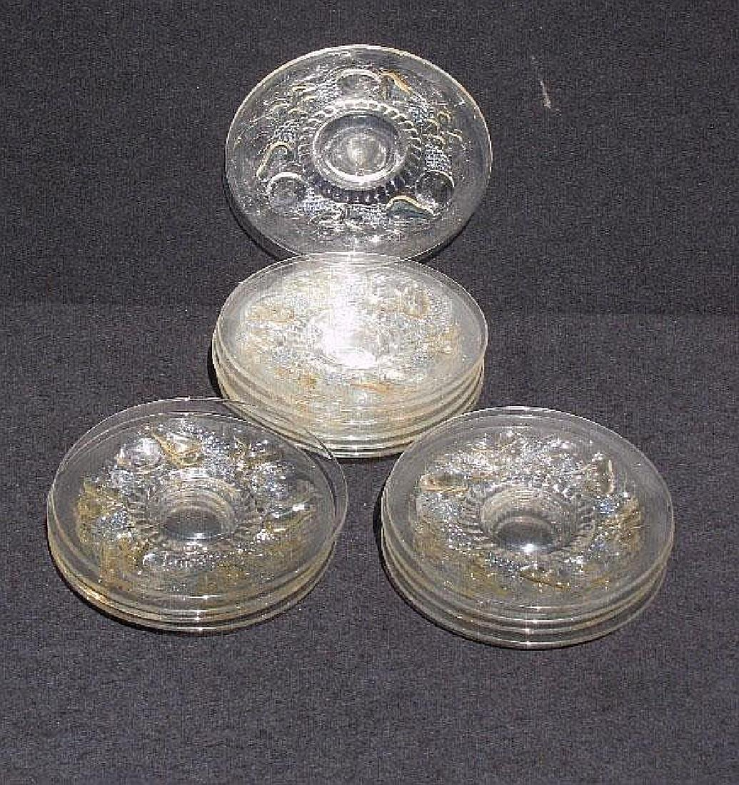 Set of 14 clear and colored glass fruit plates.