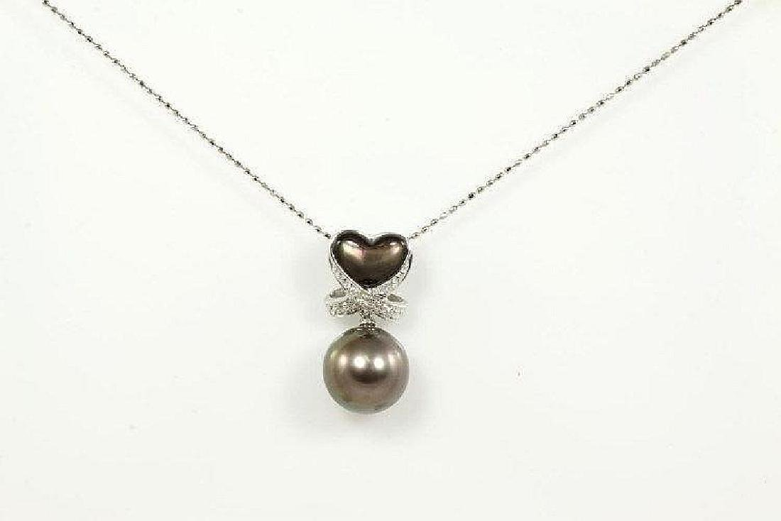 Pearl, Diamond and Shell pendant with Tahitian Pearl