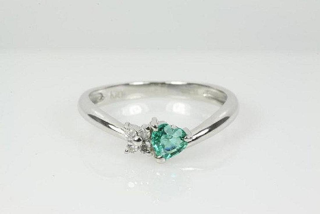 Emerald and Diamond ring with a heart shaped Emerald of