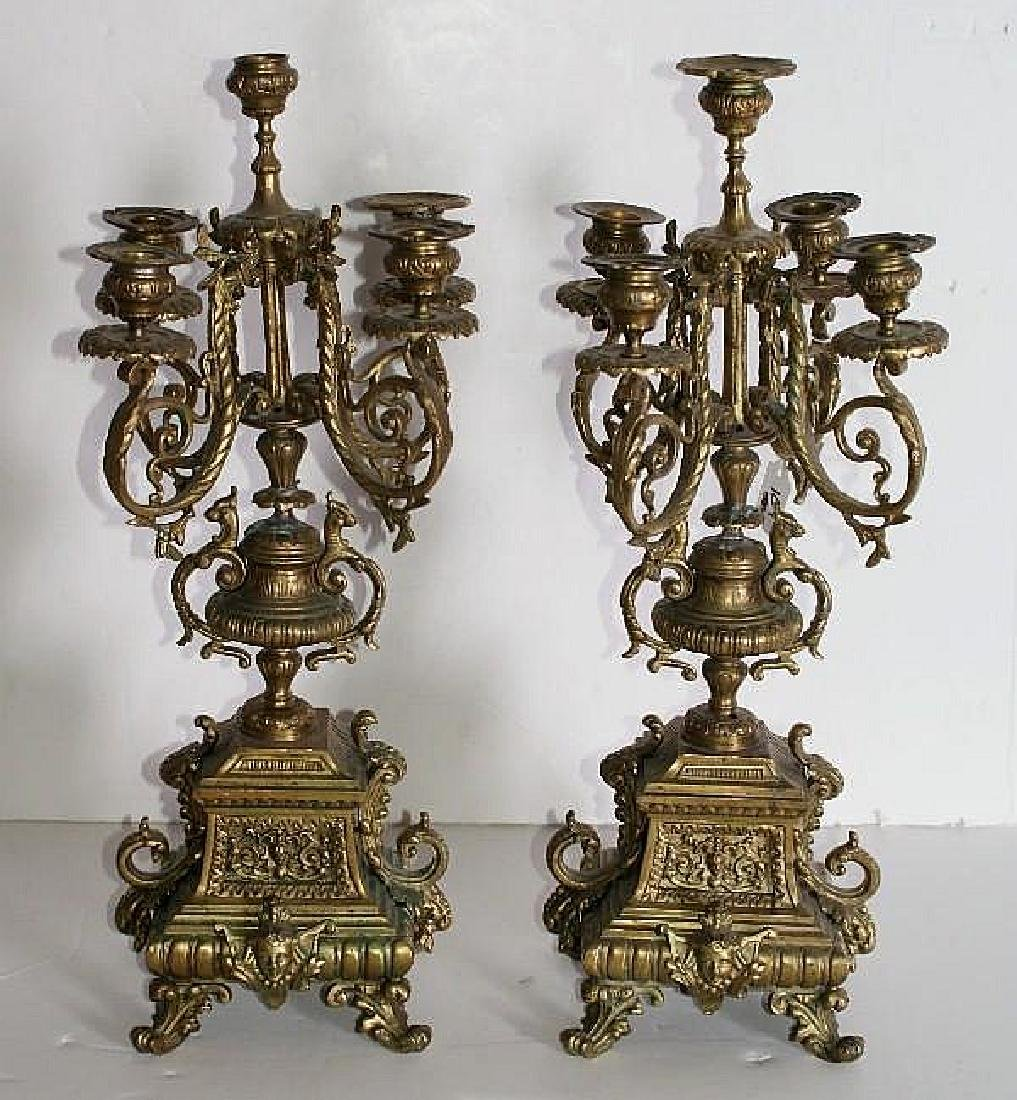 Pair of Continental bronze five-light candelabra.