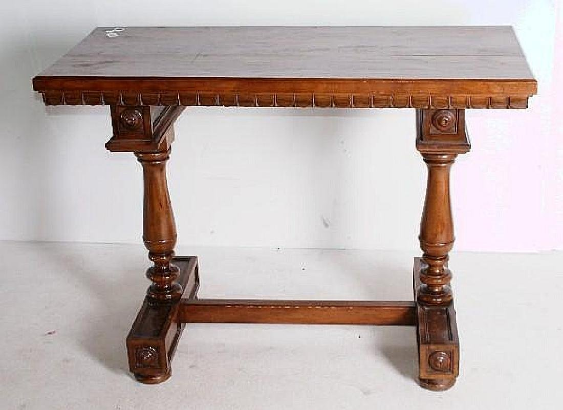 Continental carved mahogany center table with trestle