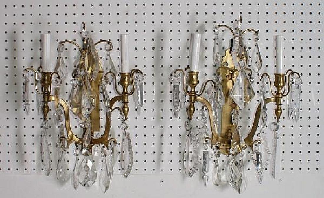 Pair of Continental bronze and crystal two light wall