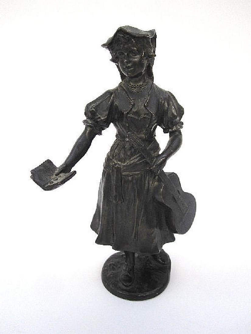 A bronze figure of a maiden holding a guitar in her