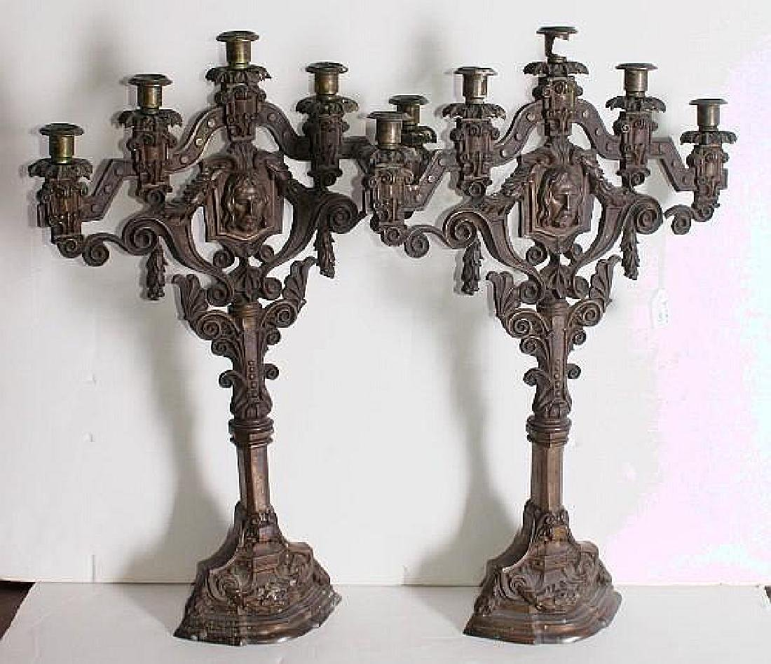 Pair of Continental bronze five-light alter candelabra,