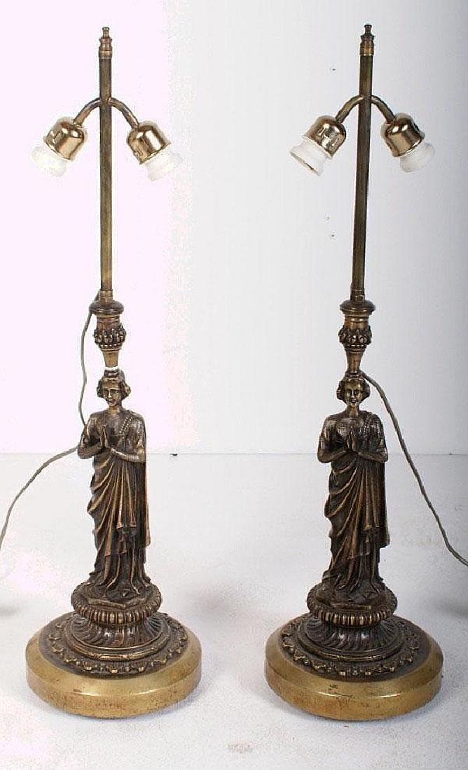 Pair of Continental bronze figural two-light table