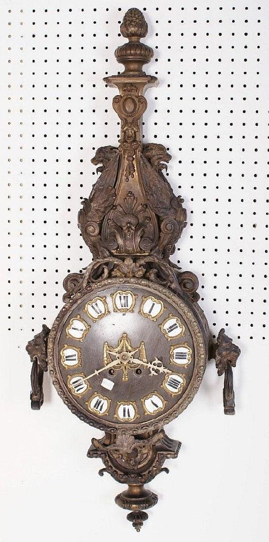 Rococo style bronze hanging wall clock with griffins