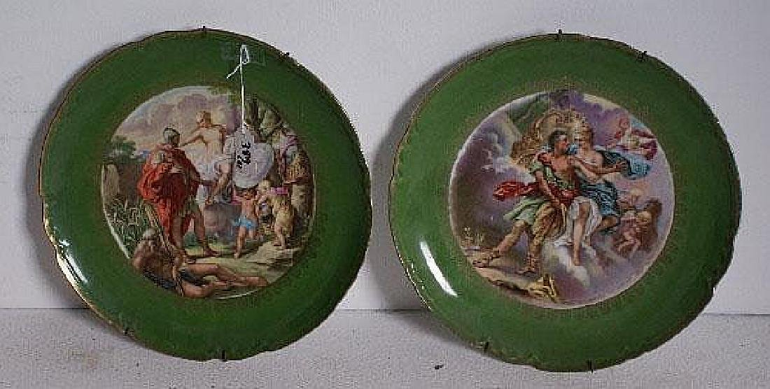 Pair of Continental porcelain chargers.