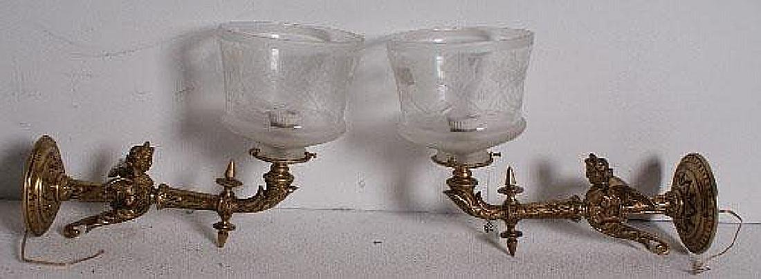 Pair of gilt-bronze figural gas-light style sconces