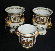 Pair of Limoges porcelain gilt decorated urns and a