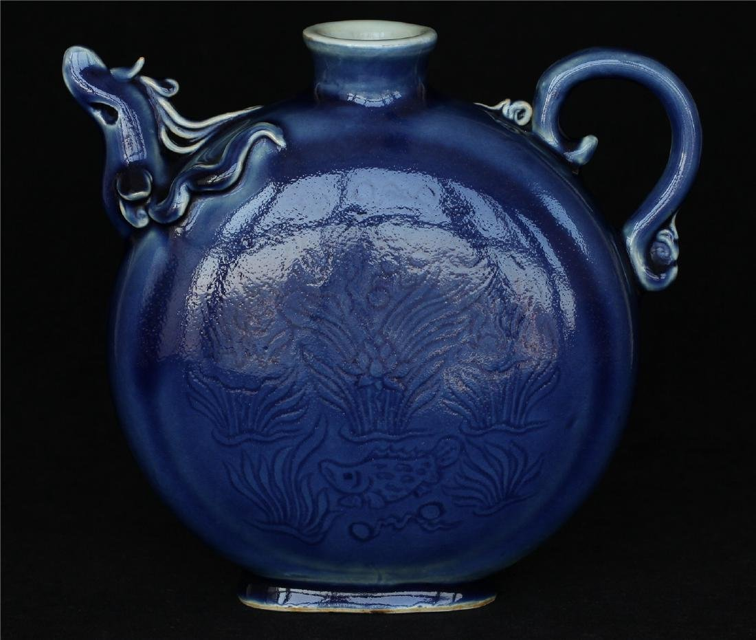 Blue glaze carving porcelain pot of Ming Dynasty YongLe