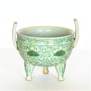 A Chinese green color porcelain three-legged censer