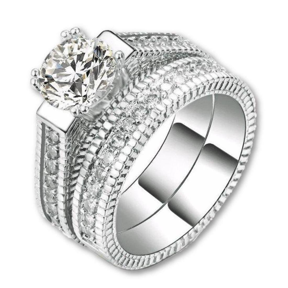 Two Rounds Cubic Zirconia Platinum Clad Ring