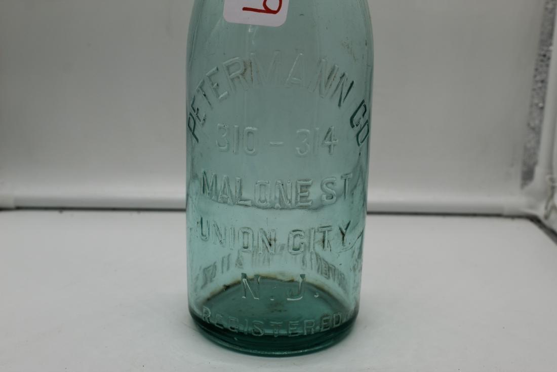 Lot of 14 unique glass bottles - 9