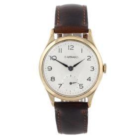 GARRARD - a mid-size wrist watch. 9ct yellow gold case