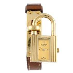 HERMÈS - a lady's Kelly wrist watch. Gold plated