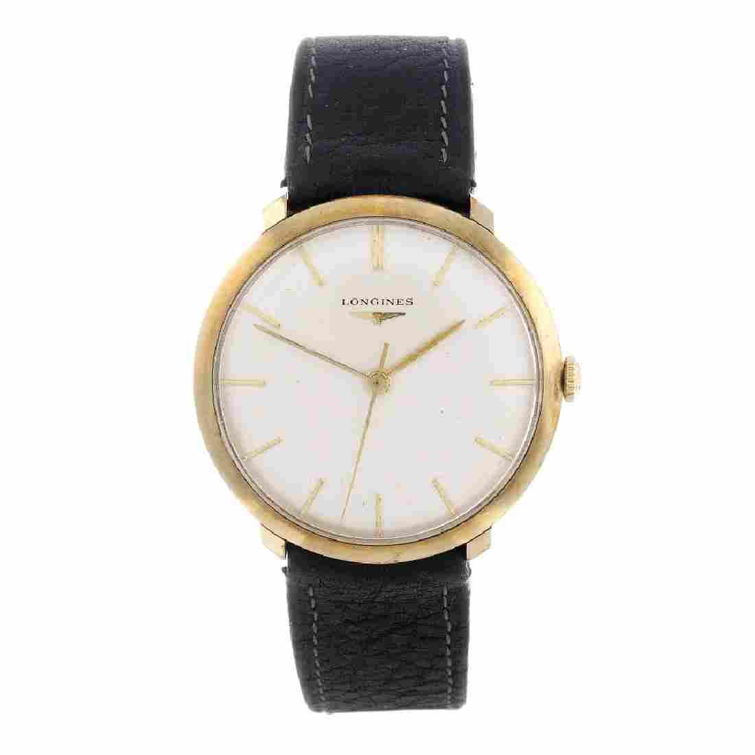 LONGINES - a gentleman's wrist watch. Yellow metal case