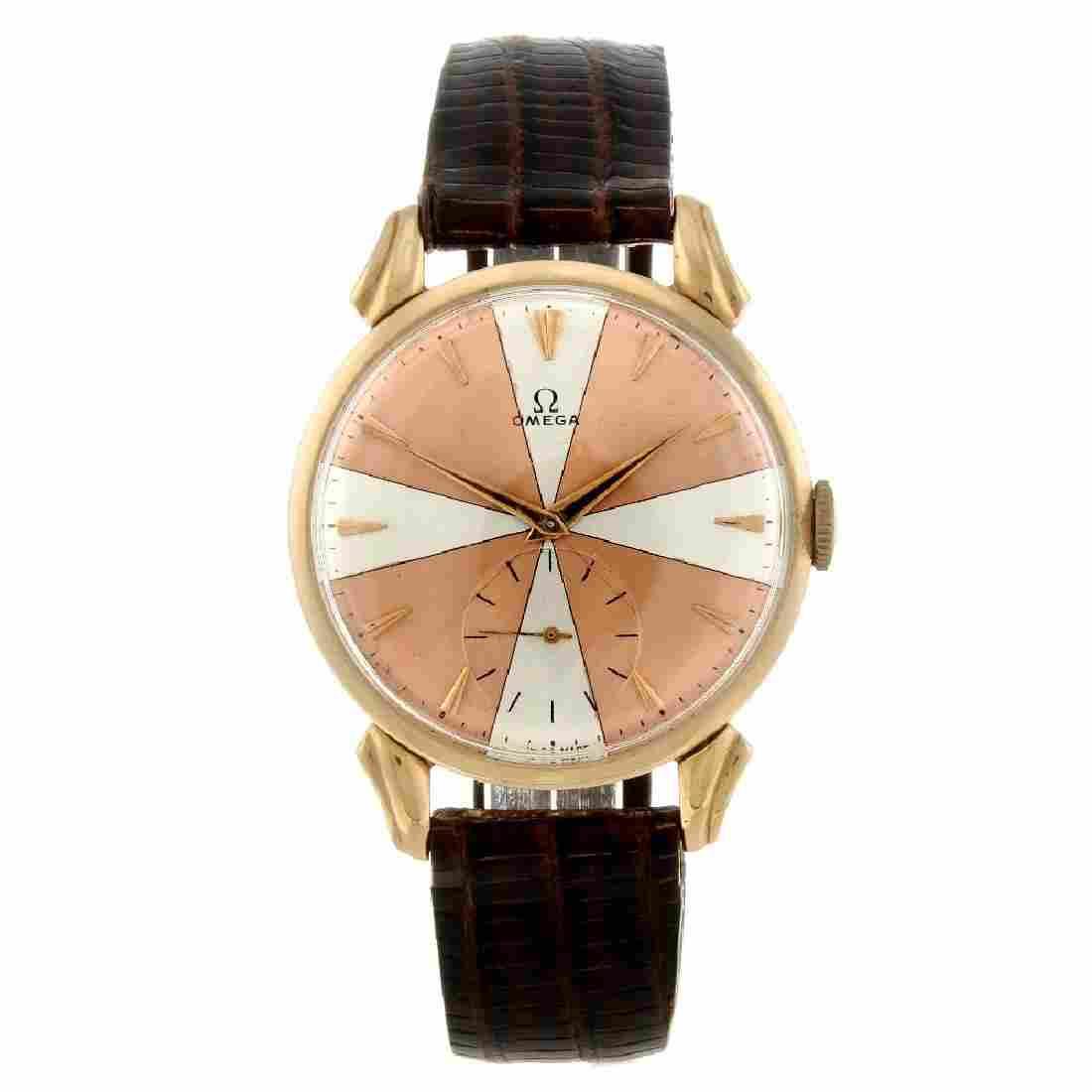 OMEGA - a gentleman's wrist watch. Yellow metal case.
