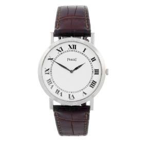 PIAGET - a mid-size wrist watch. White metal case,