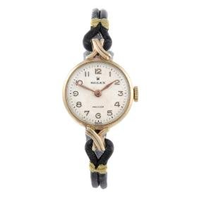 ROLEX - a lady's Precision wrist watch. 9ct yellow gold