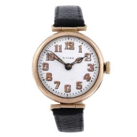 ROLEX - a gentleman's wrist watch. 9ct yellow gold